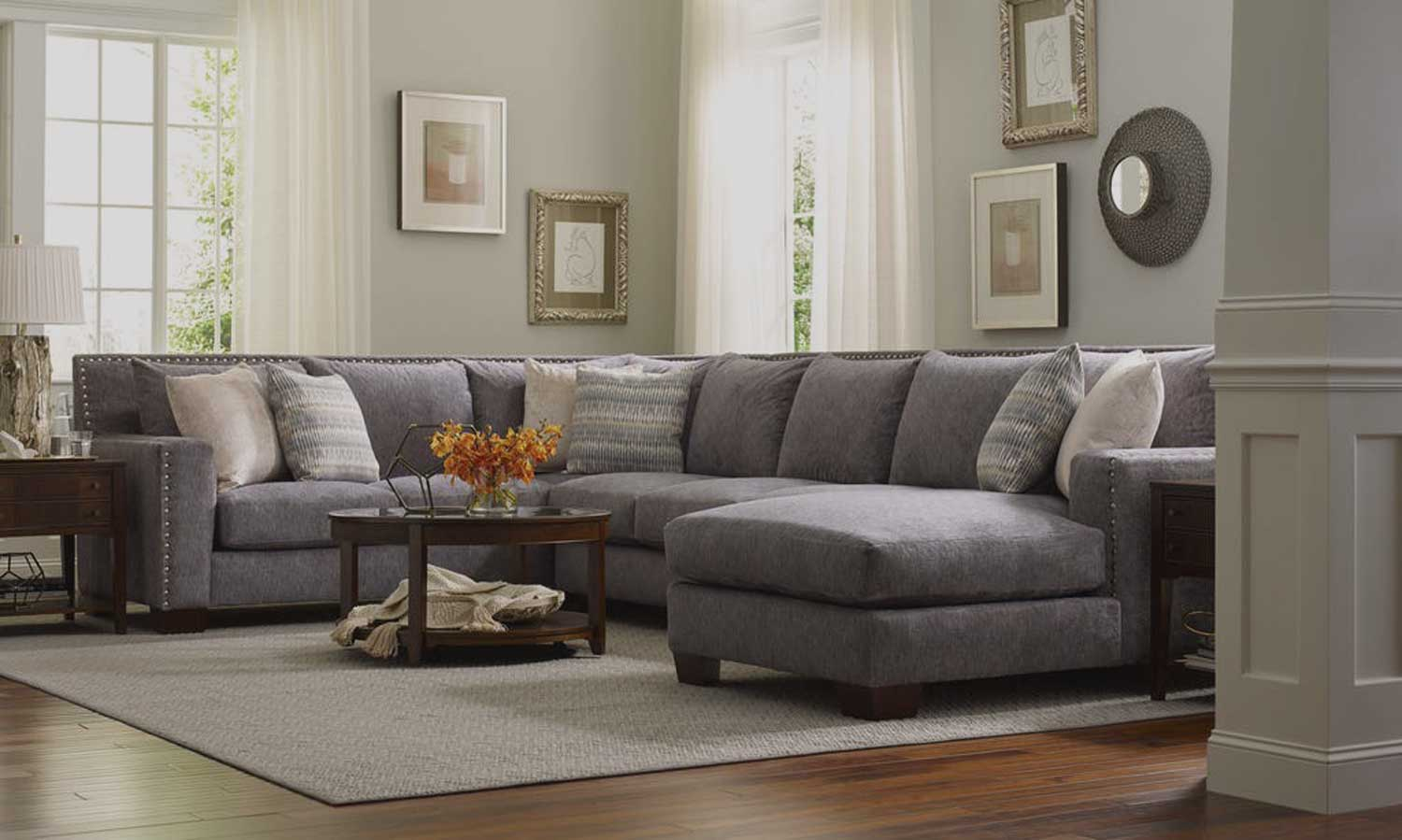 Image of a large, grey sectional couch used to promote England Company items at DeMeyer.